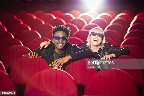multi ethnic young couple in the 3d cinema - izusek stock pictures, royalty-free photos & images