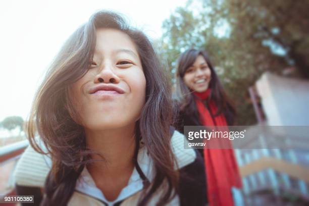 Multi ethnic young female friends expressing freedom and fun.