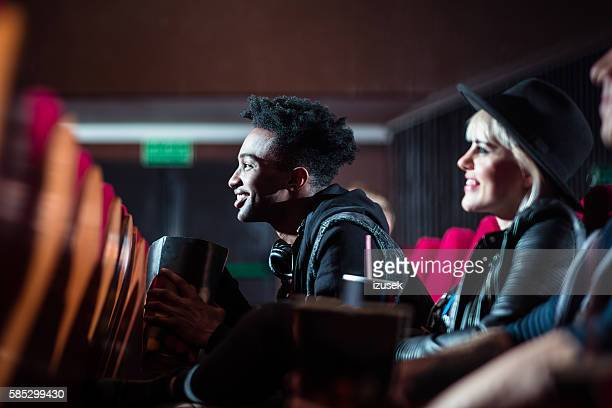 multi ethnic young people in the movie theater - the favourite film stock photos and pictures