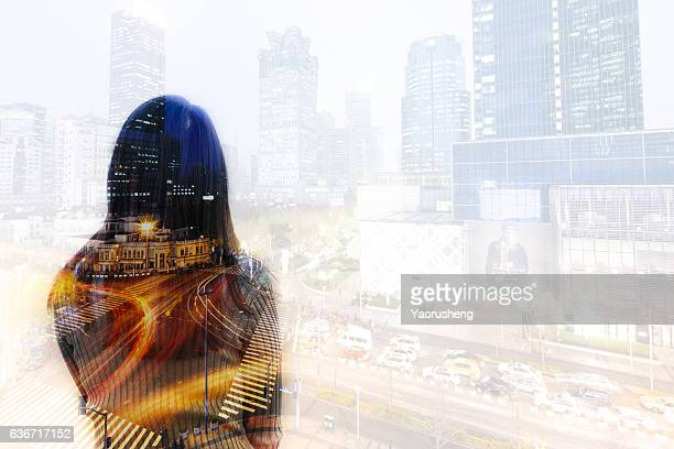 Multi exposure of woman looking at city traffic in night