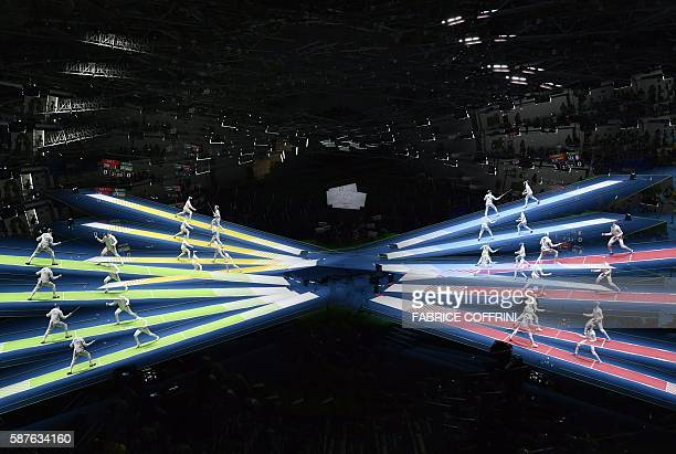 TOPSHOT A multi exposure picture shows fencers competing during the mens individual epee qualifying rounds as part of the fencing event of the Rio...