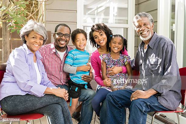 multi generation african american family smiling, portrait - african american ethnicity photos stock photos and pictures