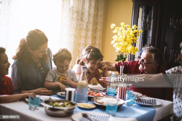 multi generation family dinner - evening meal stock pictures, royalty-free photos & images