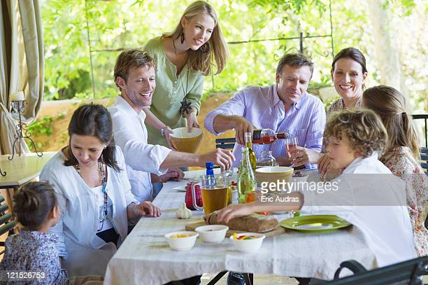 Multi generation family eating food at house