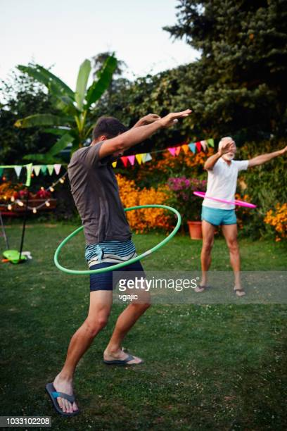 multi generation family hula hooping back