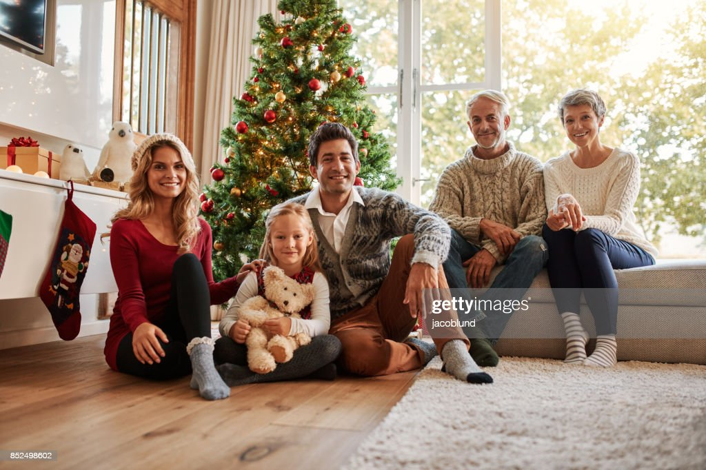 Multi generation family in front of christmas tree : Stock Photo
