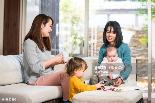 multi- generation family relaxing together at home - tdub_video stock pictures, royalty-free photos & images