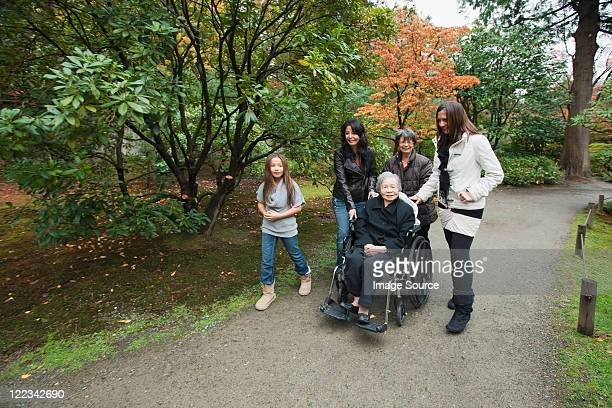 Multi generation family with senior woman in wheelchair