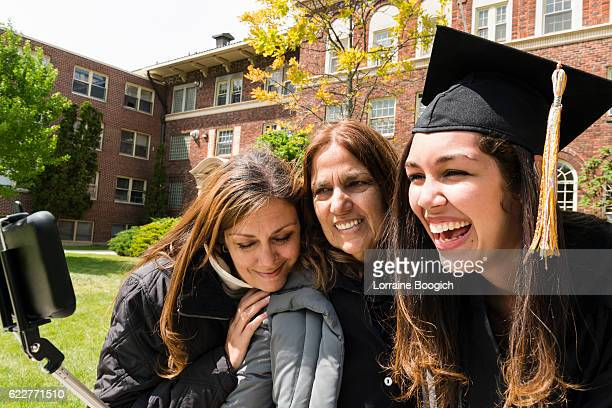 multi generational family american hispanic women celebrating graduation day usa - puerto rican ethnicity stock pictures, royalty-free photos & images