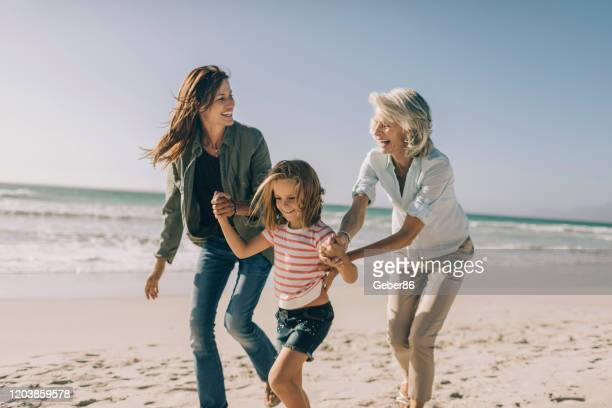 multi generational family - multi generation family stock pictures, royalty-free photos & images