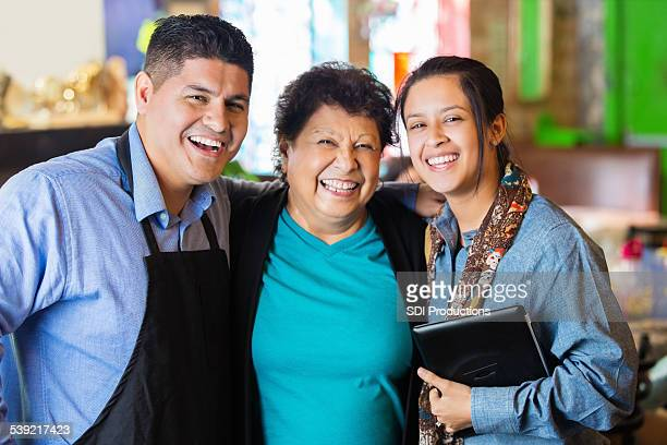 Multi generational Hispanic family in their local restaurant