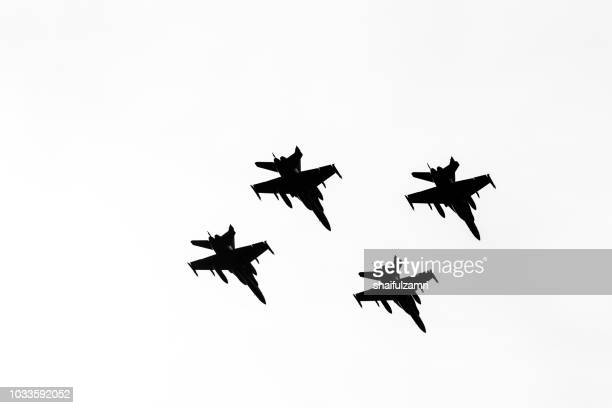 multi jet fighters from air force of malaysia fly-by during the 61st independence day celebration held at the administrative capital of putrajaya. - shaifulzamri - fotografias e filmes do acervo