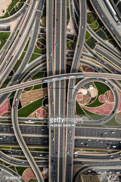 multi lane highway intersections shot from above, united arab emirates - dubai stock pictures, royalty-free photos & images