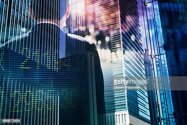 Multi layered businessman with building