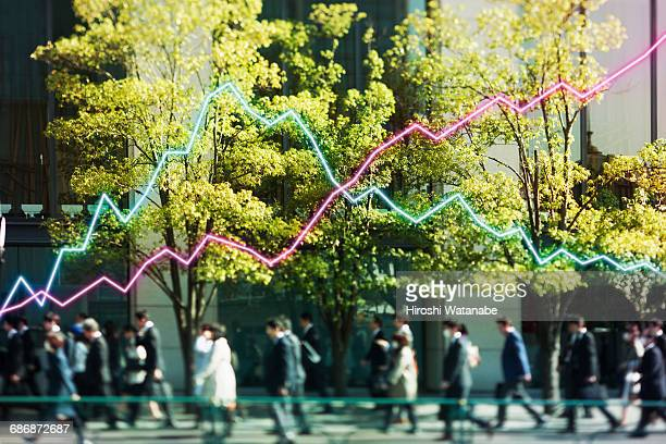 Multi layered businessmen with line graph
