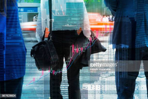 Multi layered, businessmen with stock market graph