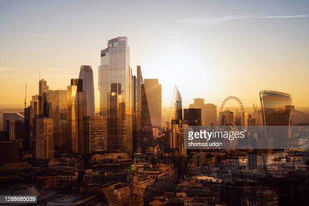multi layered cityscape of london skyline at sunrise - aerial view - sunrise dawn stock pictures, royalty-free photos & images