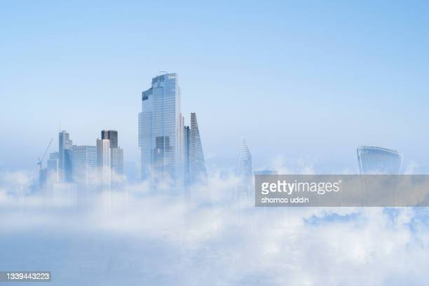 multi layered cityscape of london skyline emerging through clouds - appearance stock pictures, royalty-free photos & images
