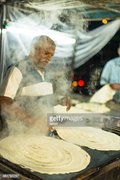 multi layered indian flat bread - dosa stock photos and pictures