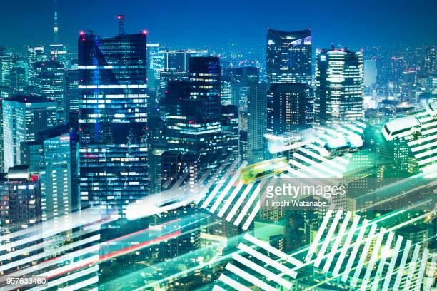 Multi layered, night cityscape with light trail