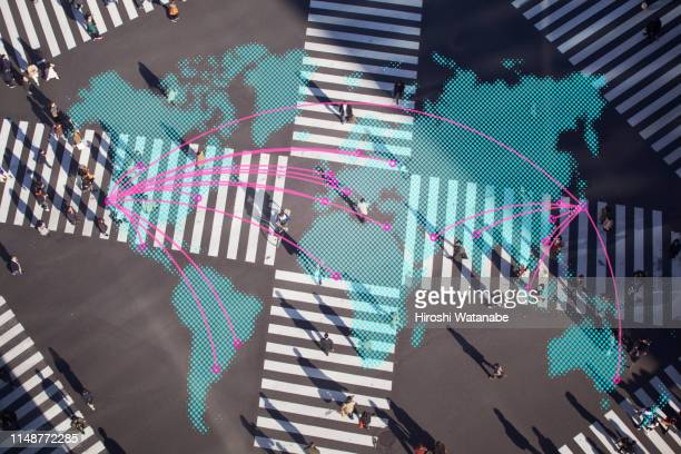 multi layered, people walking on a pedestrian crossing with world map - international match photos et images de collection
