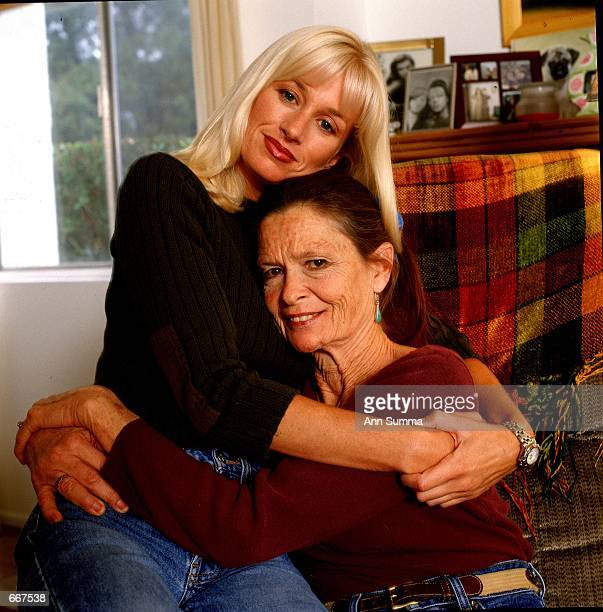 Multi Million dollar bride Darva Conger hugs her mother and her dog March 2000 in her livingroom in Thousand Oaks California