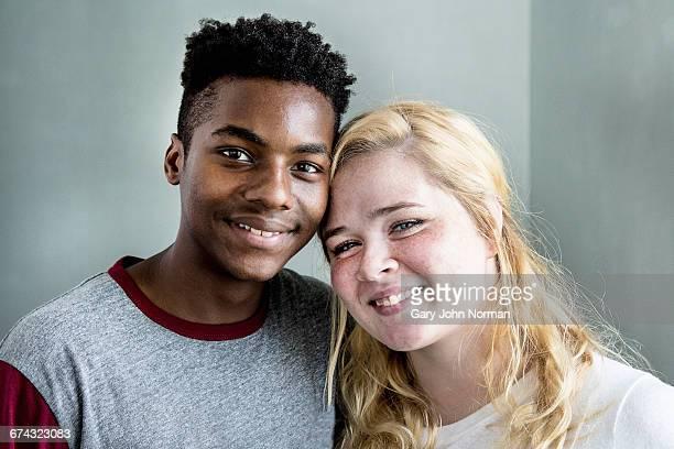 Multi race young couple, studio shot