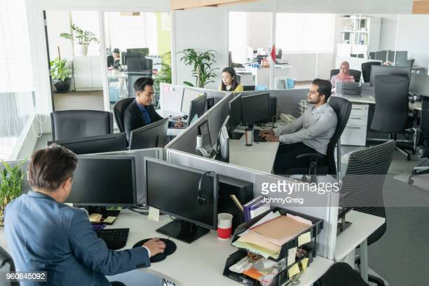 Multi racial business people working in modern office