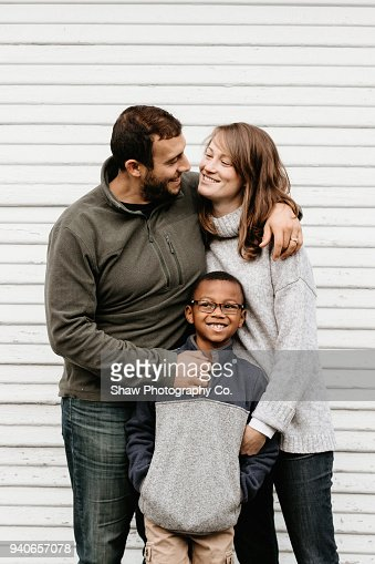Multi racial family photos with adoptive son