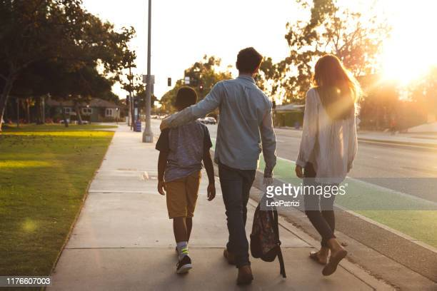 multi racial family with adoptive children spending time together at the park - adoption stock pictures, royalty-free photos & images