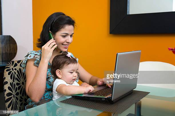 multi tasking mother with child - mexican and white baby stock photos and pictures