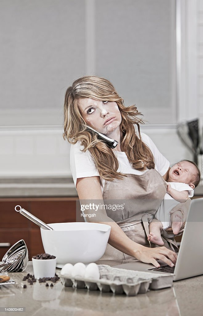 Multi Tasking New Mom : Stock Photo