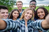 Multi_ethnic Teenagers Taking a Self Portrait stock photo