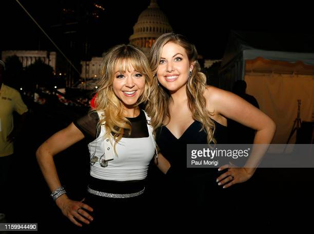 Multiaward winning electronic violinist Lindsey Stirling and the 2019 winner of THE VOICE Maelyn Jarmon pose for a photo backstage during A Capitol...