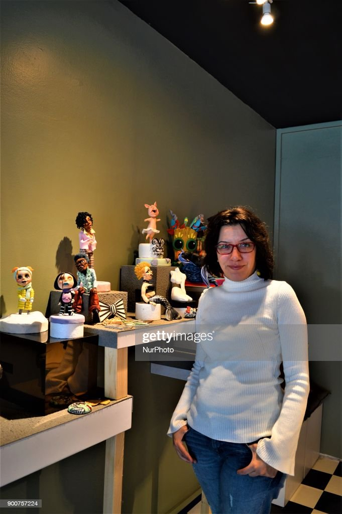 Multi-award-winning Turkish sugar artist Ayca Duman Kaleli poses for a photo at her cake design workshop in Ankara, Turkey on January 3, 2018. Kaleli designs different kinds of characteristic figures in her workshop, while her family has been carrying on a pastry shop for five generations.