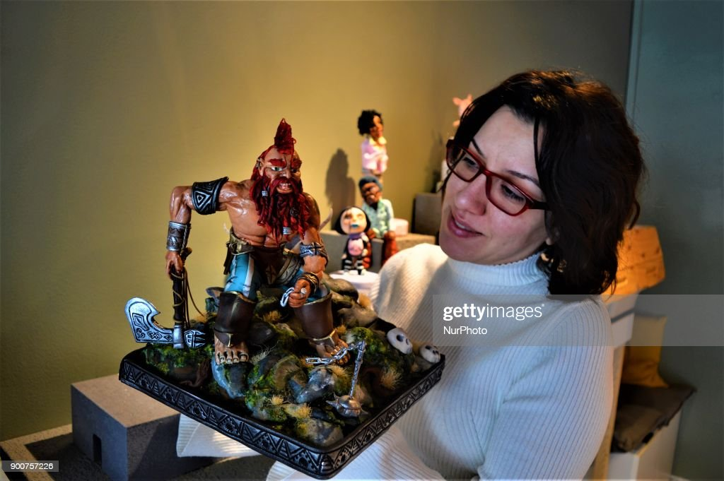 Multi-award-winning Turkish sugar artist Ayca Duman Kaleli shows an award-winning figure made from sugar paste as she poses for a photo at her cake design workshop in Ankara, Turkey on January 3, 2018. Kaleli designs different kinds of characteristic figures in her workshop, while her family has been carrying on a pastry shop for five generations.