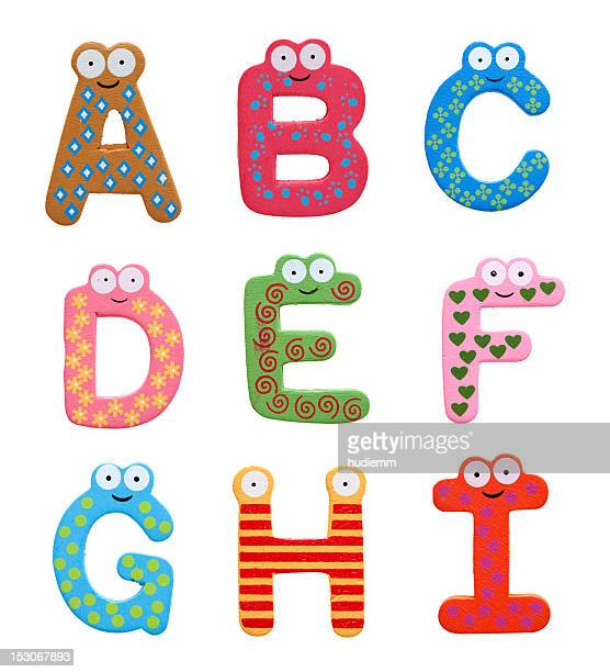 Multicolor alphabet fridge magnet letters isolated on white background