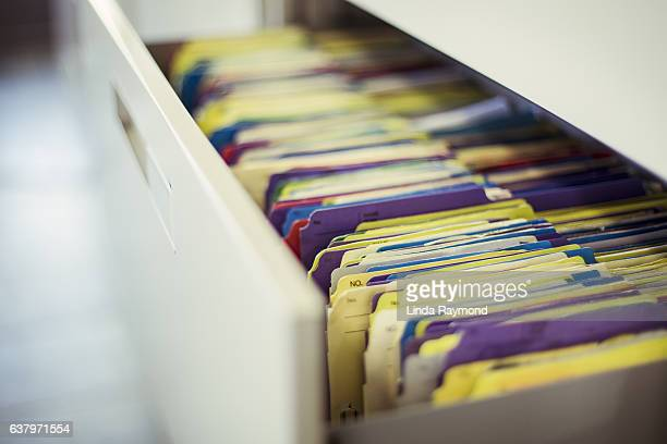 multicolor files in a clinic drawer - data privacy stock pictures, royalty-free photos & images