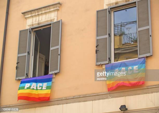 Multicolor flag with the colors of the rainbow on the streets of Rome