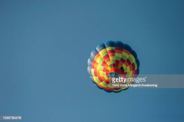 A multicolor hot air balloon in flight during the Ferrara Balloons Festival the most important hot air balloon festival in Italy on September 15 2018...