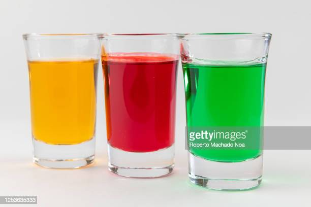 multi-color liquors on shot glasses - studio shot stockfoto's en -beelden