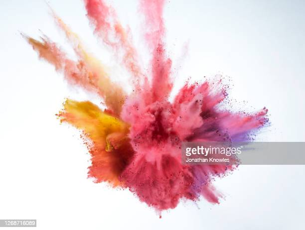 multicolor powder explosion - bombing stock pictures, royalty-free photos & images