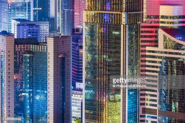 multicolor skyscrapers illuminated at night in chengdu - international match photos et images de collection