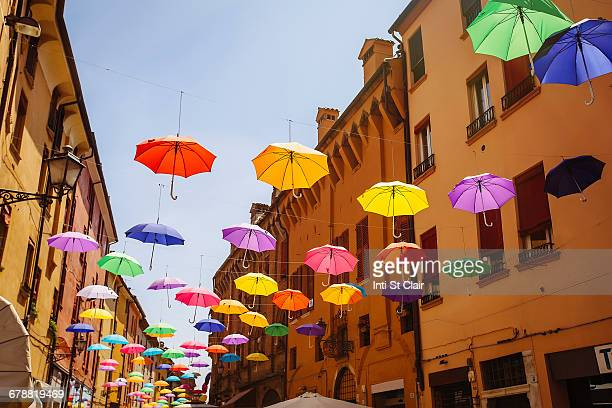 Multicolor umbrellas hanging outdoors, Bologna, Emilia-Romagna, Italy