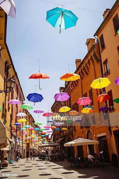 Multicolor umbrellas hanging over street, Bologna, Emilia-Romagna, Italy