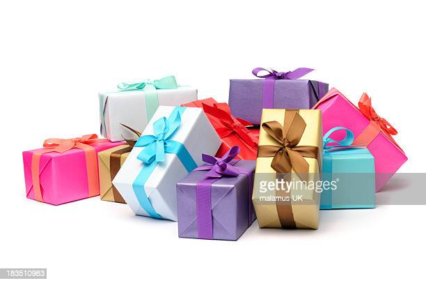 multicolored and beribboned gift boxes in pile - gift stock pictures, royalty-free photos & images