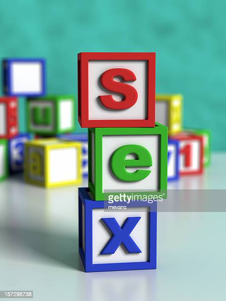 Multicolored and lettered building blocks spell out sex