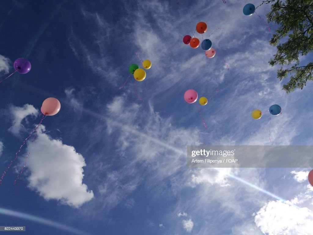 Multicolored balloons in the air : Stock Photo