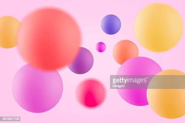 multi-colored balls in mid air - bouncing ball stock photos and pictures