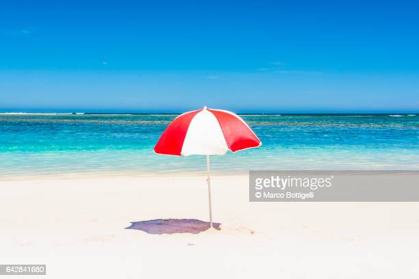 A multicolored beach umbrella on the shore. Western Australia